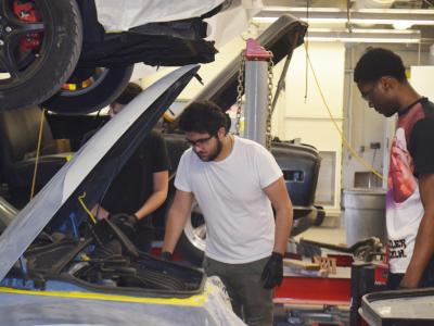 Automotive Collision and Technology students work on late model vehicles provided through community auto donations.