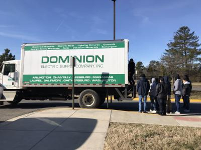 Electrical students unload a shipment of materials supplied by Dominion Electric and supporters by our partners, IBEW Local Union #26.